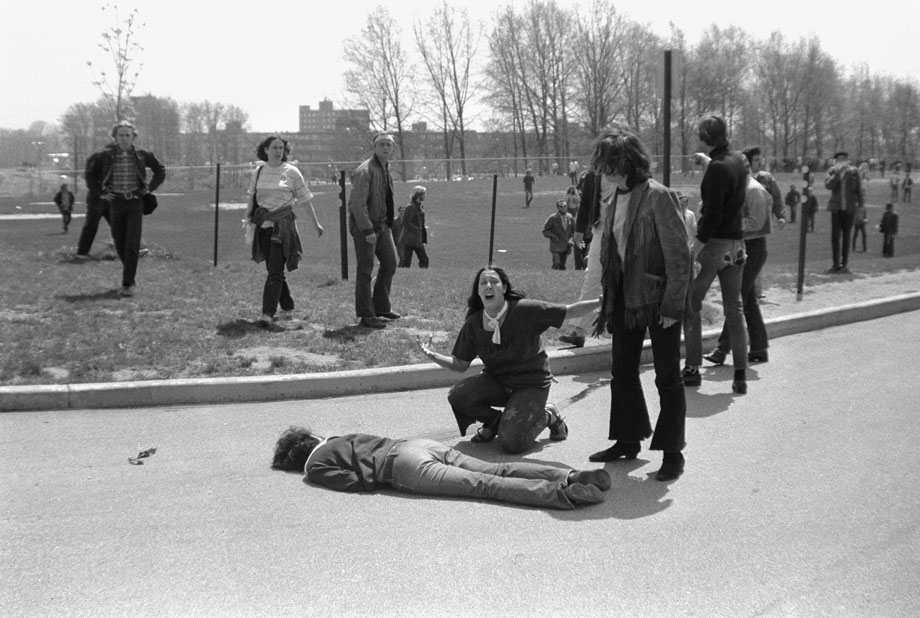 Mary Ann Vecchio screams as she kneels over the body of fellow s